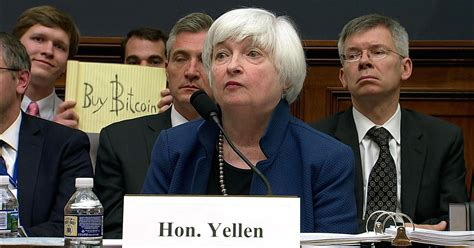 bitcoin the one hour guidance you need before investing in bitcoin or other cryptocurrency books someone held up a buy bitcoin sign during yellen s