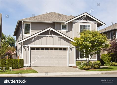 blue sky garage suburban home with front porch garage and blue sky stock