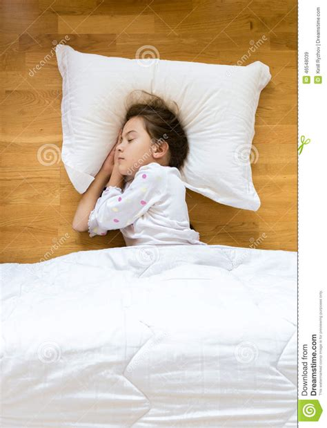 Sleeping On The Floor Without A Pillow by Sleeping On Wooden Floor On White Pillow Stock