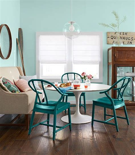 dining space featuring eclectic teal green dining chairs teal painted dining chair interiors by color