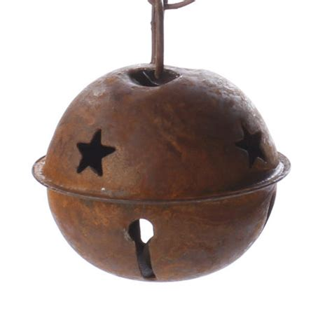 rusty tin sleigh bell christmas and holiday primitive