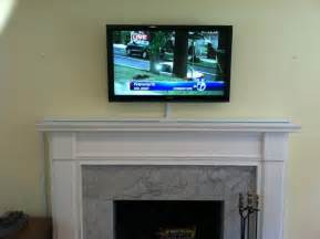 mount tv above fireplace hide wires how should i run wiring for my above fireplace mounted tv