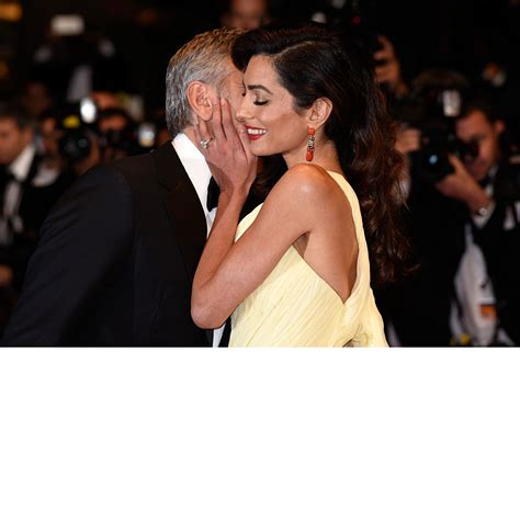 George Clooney Kisses For The Right Price by George Clooney And Amal Clooney S Best Carpet Moments