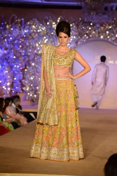 home indian wedding site vendors clothes invitations abu jani sandeep khosla golden peacock indian bridal show