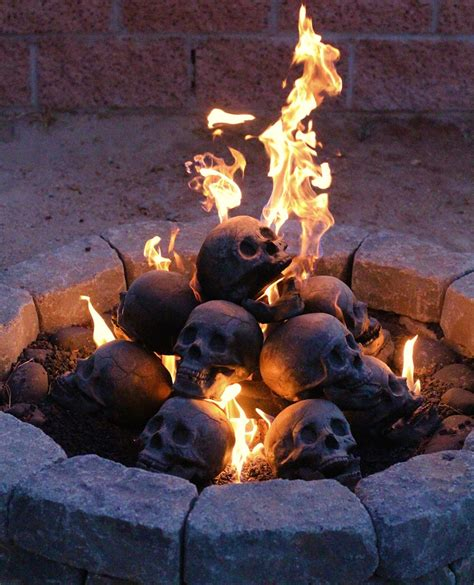 Burning Logs For Fireplace by Skull Fireplace Quot Logs Quot The Awesomer