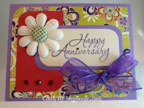 a purple and anniversary cards by