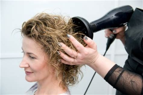 Drying Curly Hair With A Diffuser how to get more volume to the roots of curly hair when