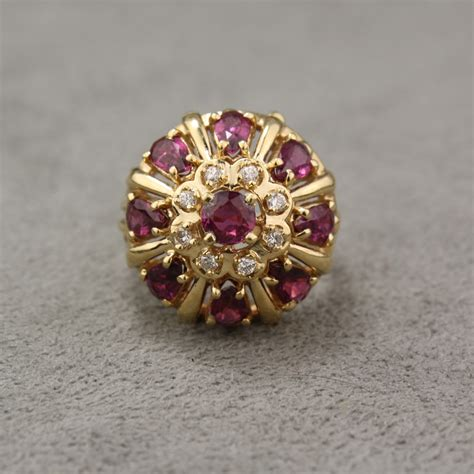 vintage 14 karat yellow gold ruby and cluster ring