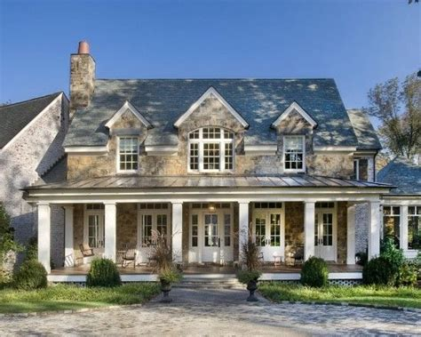 home exterior design stone now that s a front porch stone front metal roof white