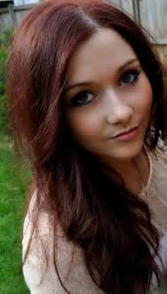 Here s a pretty girl with black cherry dyed hair and green eyes