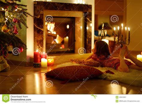 happy  girl   fireplace  christmas stock image