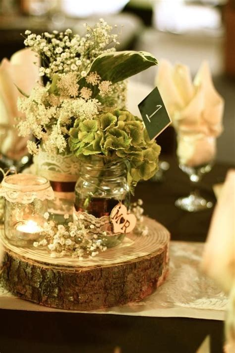 rustic log centerpieces 1000 ideas about log centerpieces on