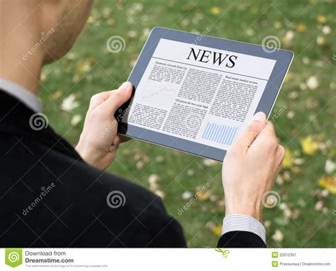 reading on tablet reading news on tablet pc stock image image 22012391