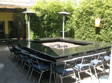 large fire pit table and square tables built from reclaimed wood ecustomfinishes