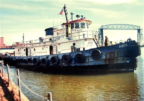 tugboat goes under bridge tugboat goes from trash to treasure gcaptain