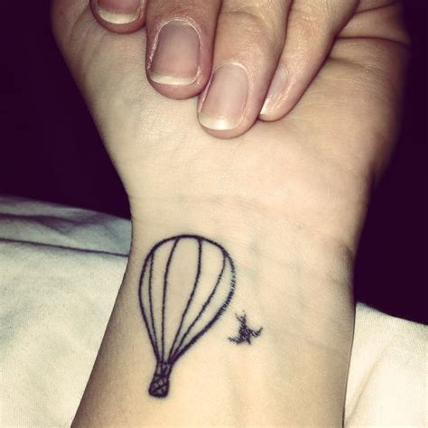 small first tattoos my of a air balloon and a
