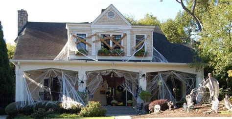 31 of the best decorated halloween houses gallery halloween decorations spiders web to spook up everyone