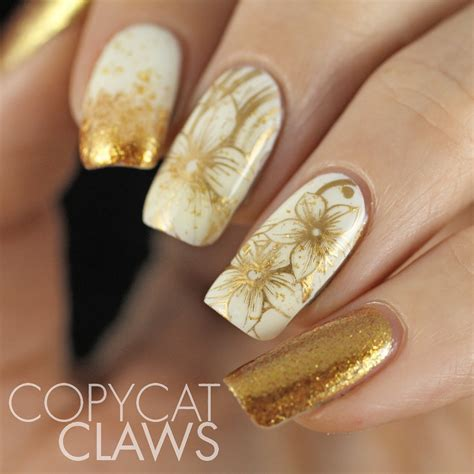 gold nail design copycat claws sunday sting white and gold nails