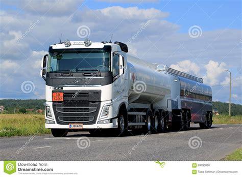 white volvo truck white volvo fh tank truck adr on summer road editorial