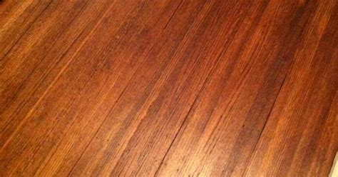 wood floors after one coat of satin poly over duraseal antique brown stain home remodel