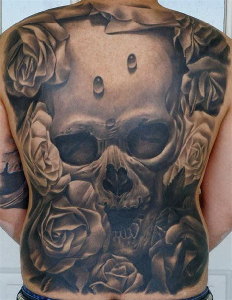 latin skulls tattoo more info on this artist in our app