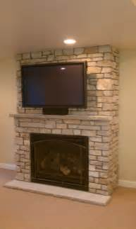 Track Arm Sofa by Electric Fireplace Also Television On It And Cream Color