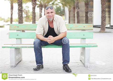 guy sitting on bench man sitting on a bus stop bench stock image image 23172751