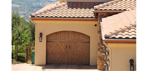 How To Make Garage Door Quieter by How To A Noisy Garage Door Garage Door Cowboys