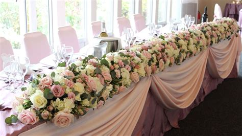 top table with dusky pink top table decorations wedding venue decorations top table flowers
