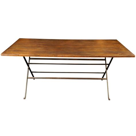 sawbuck dining table walnut and steel sawbuck dining table at 1stdibs
