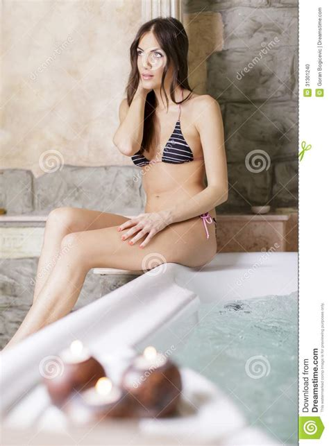 sexy bathtub pretty young woman relaxing in the hot tub stock photo
