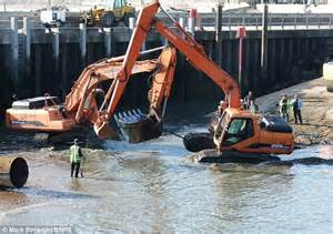 excavator sinking boat worker gets that sinking feeling as 22 ton digger gets