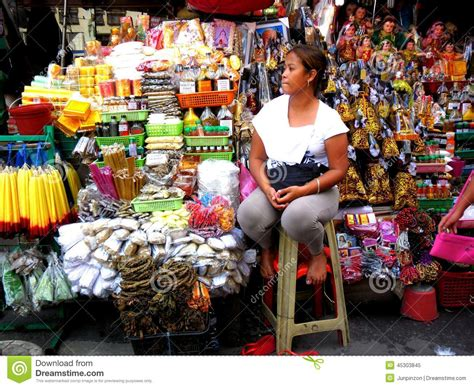 Firshing Anting market vendor selling religious items beside quiapo church
