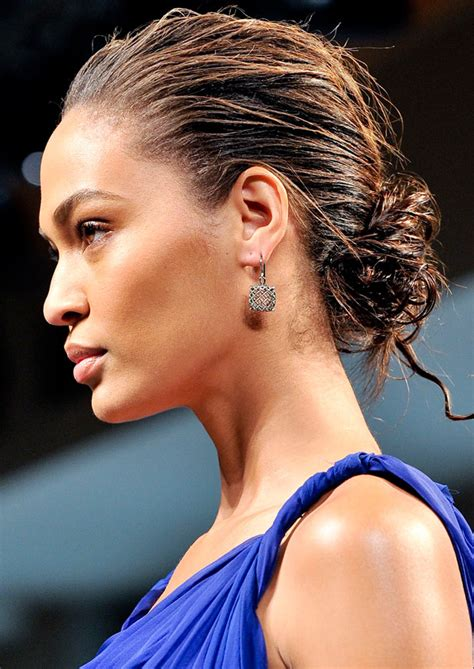 wet and messy hair look wet look chignon hairstyle