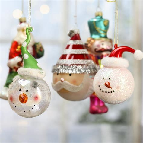 assorted glass christmas ornaments signs ornaments
