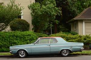 parked cars 1966 dodge dart