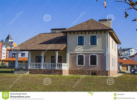 newly built alpine house in german stock photo
