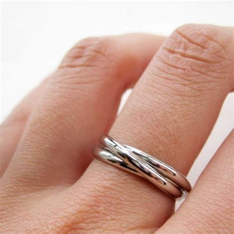 three connected rings linked into one ring in silver