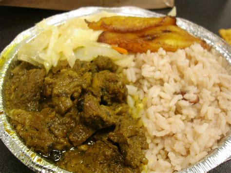 Curry goat w rice amp peas plantains amp cabbage