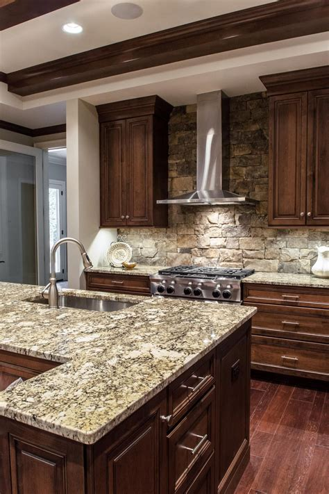 limestone kitchen backsplash custom wood cabinets and gray stone countertops are top