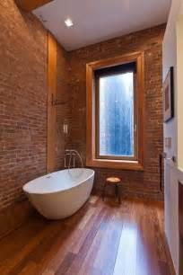 nyc bathroom design incorporating exposed bricks in stylish designs around the