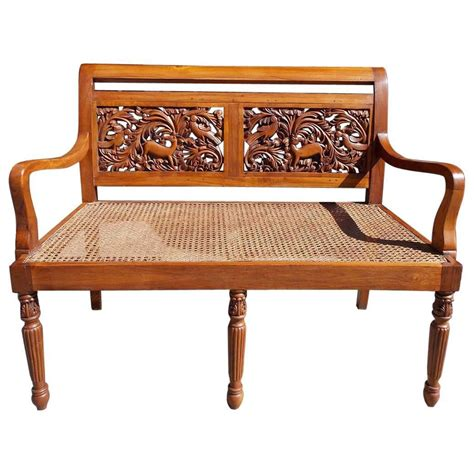wooden settees caribbean kings wood carved foliage and animal cane settee