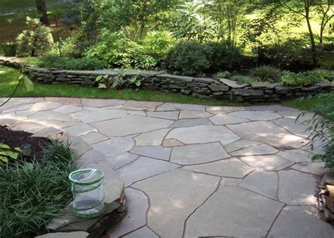 flagstone is a flat natural colored stone that has been used on patios and walkways for many