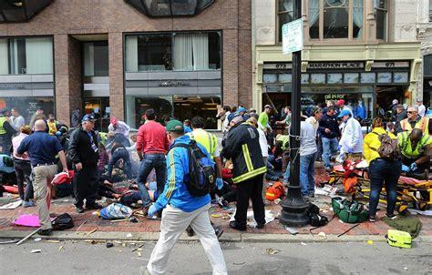 boston marathon bombing images at boston bombing strangers ran toward chaos not away