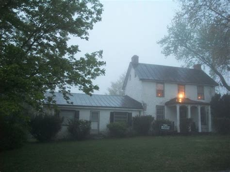 front of the house foggy picture of the haunted
