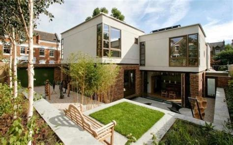 eco friendly home familly family of architects create twin eco homes one of them on