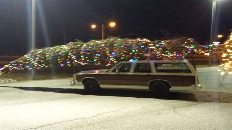 griswold christmas tree on the car in my town made his station wagon into the griswold vacation car meme