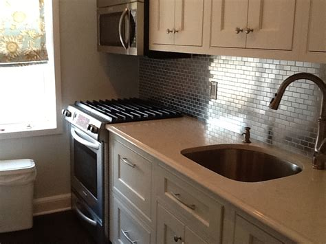 kitchen with stainless steel backsplash go stainless steel with your backsplash subway tile outlet