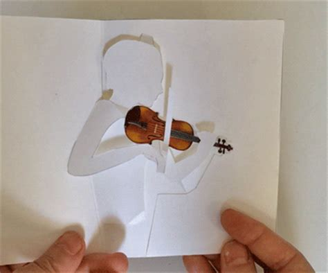paper violin template printable violin pop up card shows violinist bowing