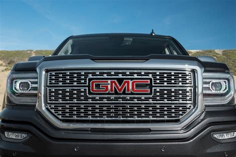 gmc awards the handoff giving our truck of the year award to